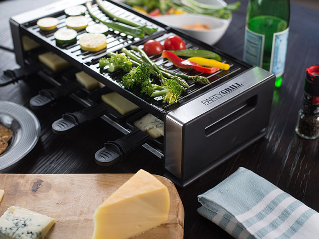 A tabletop grill with vegetables