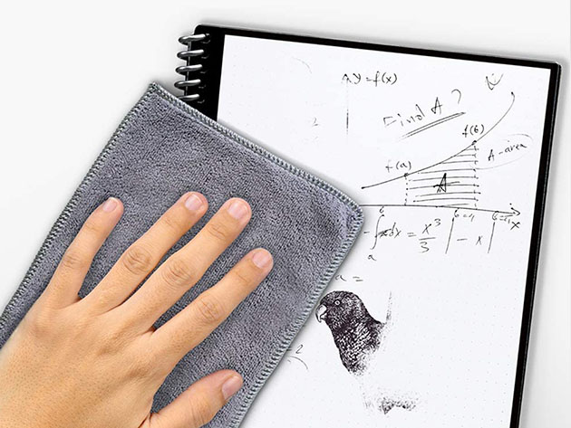 A person wiping off a reusable notebook.