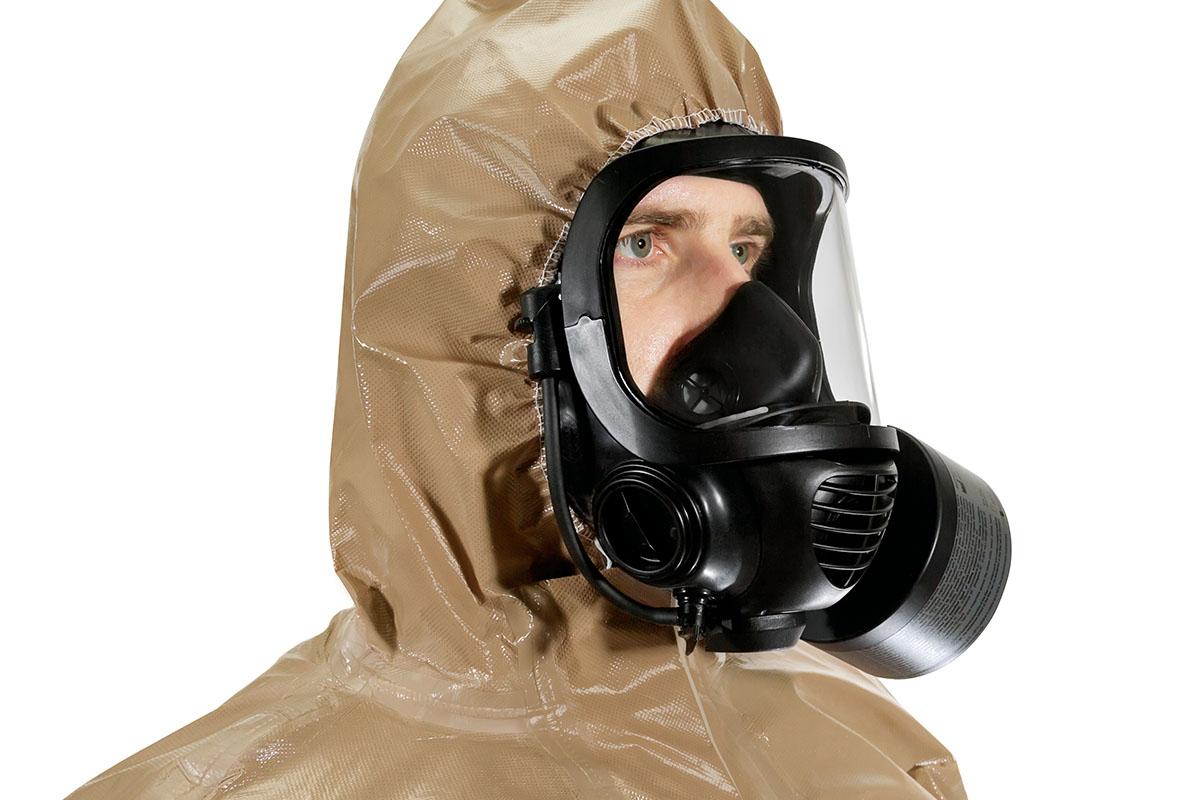 A man wearing a protective CBRN Hazmat suit