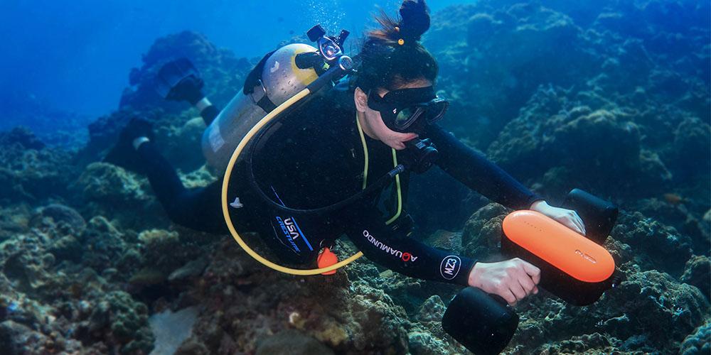 A person SCUBA diving