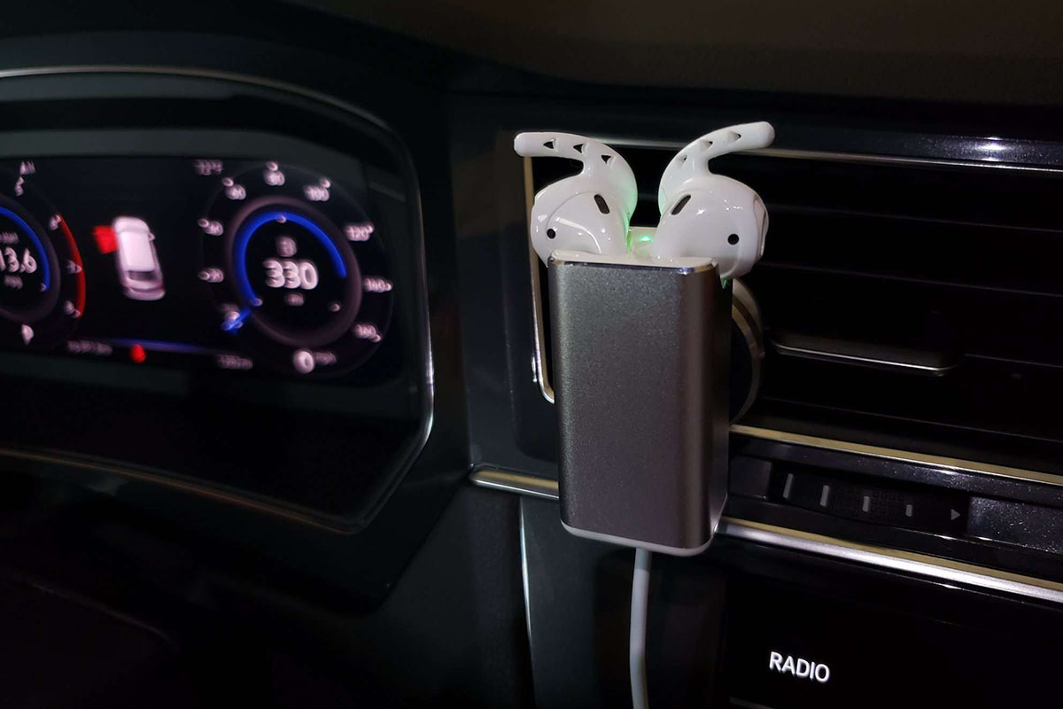 A car with an AirPod charging device installed.