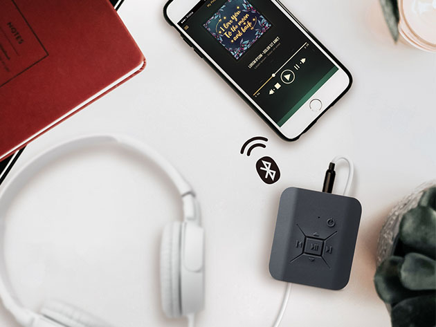 A bluetooth amp, with headphones and a phone