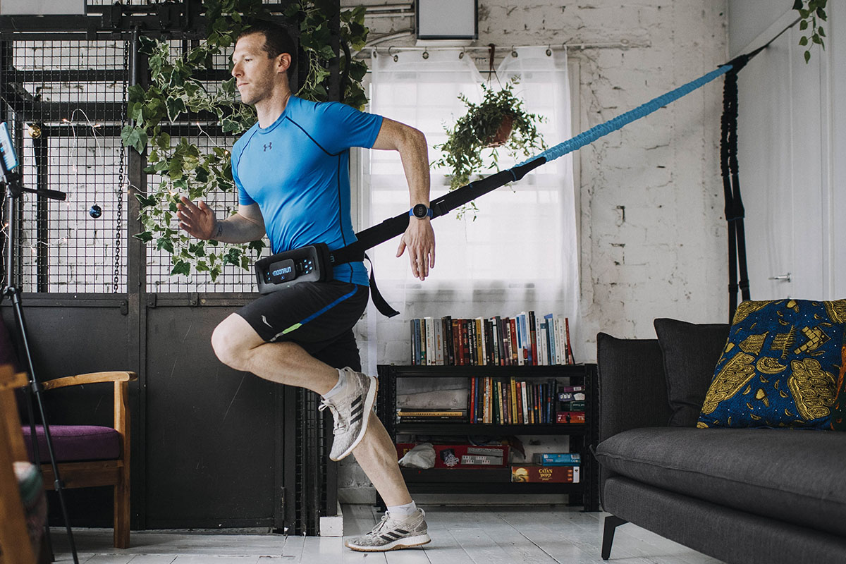 A person using a MoonRun cardio trainer