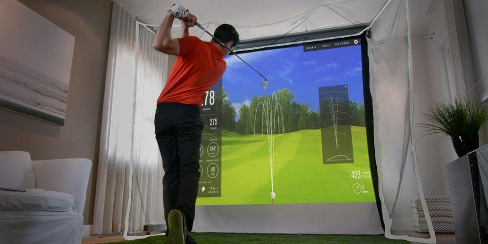 A person using a golf simulator.
