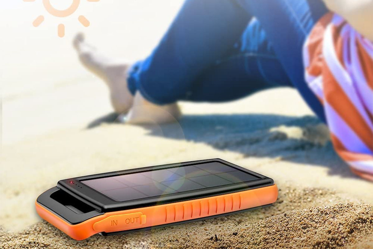 A solar power bank sitting on the sand