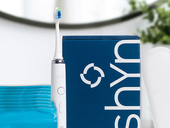 Shyn Sonic Toothbrush with Whitening Brush Heads & Flossers