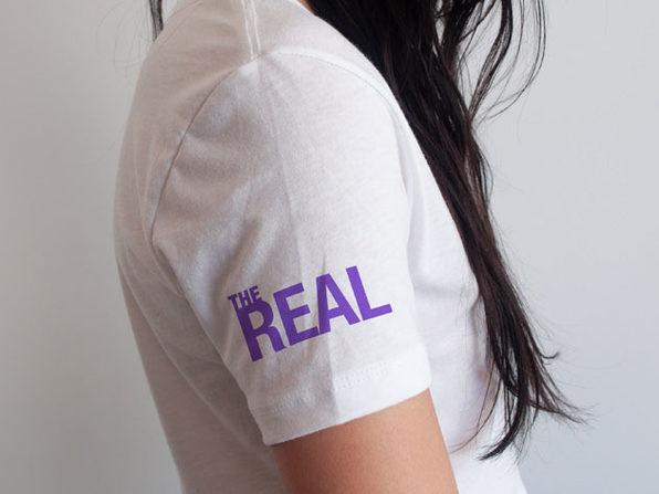 'The Real' Arm Logo White V-Neck T-Shirt (XL)