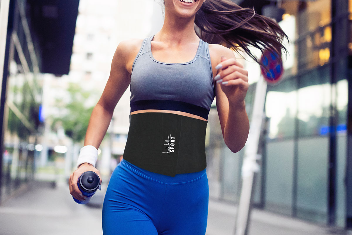 A person jogging, wearing a slimming belt