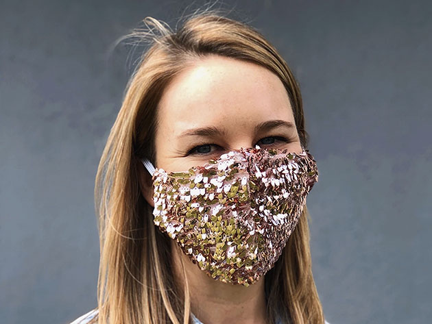 A person wearing a sequin face mask